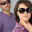 Young woman and man wearing sunglasses — Stock Photo