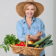 Woman with a vegetable basket — Stock Photo