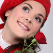 Happy brunette holding a red rose — Stock Photo