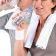 Royalty-Free Stock Photo: Couple senior drinking water after training