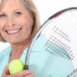 Elderly womplaying tennis — Foto de stock #16186263