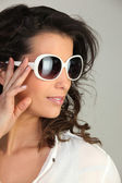 Woman with modern sunglasses — Stock Photo