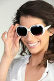 Woman wearing oversized sunglasses — Stok fotoğraf