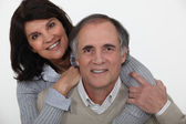 Mature couple embracing — Stock Photo