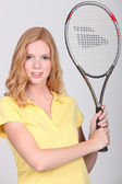 Teenager holding a tennis racket — Stock Photo