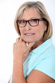 Older woman wearing glasses — Stock Photo