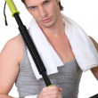 Stock Photo: Man using gym equipment