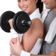 Woman lifting a dumbbell — Stock Photo #16301961