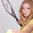 Girl playing tennis — Stockfoto