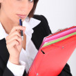 Woman with folders and pen — Stock Photo