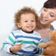 Mother son and teddy — Stock Photo #16306907