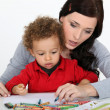 Stock Photo: Little boy and mother drawing with crayons