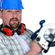Foto Stock: Tradesmholding circular saw