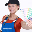 Stock Photo: Craftswoman painter holding a color chart
