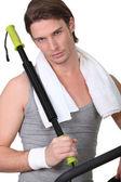 Man using gym equipment — Stock Photo