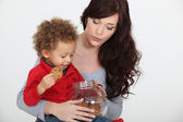Child with a cookie jar — Stock Photo