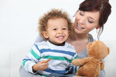 Mother son and teddy — Stock Photo