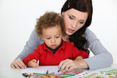 Little boy and mother drawing with crayons — Stock Photo
