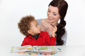 Mother and toddler coloring — Stock Photo