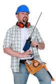 A handyman with a drill. — Stock Photo