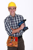 Man with a cordless screwdriver — Stock Photo