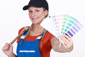Craftswoman painter holding a color chart — Stock Photo
