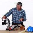Man using industrial saw — Stock Photo