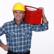 Stock Photo: Mwith toolbox on his shoulder