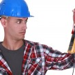 Wide-eyed tradesman staring at a multimeter — Stock Photo