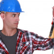 Stock Photo: Wide-eyed tradesman staring at a multimeter