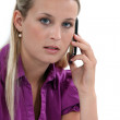 Blond woman with mobile telephone — Stock Photo