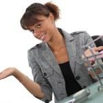 Happy receptionist presenting her work area — Stock Photo