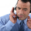 Businessman struggling to hear his headset — Foto Stock #16317379