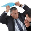 Stock Photo: Businessmhitting colleague with folder
