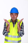 Builder with confused look on face — Stock Photo