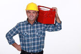 Man with a toolbox on his shoulder — Stock Photo