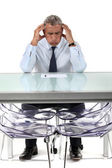 Businessman stressed over a document — Stock Photo