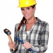 Stock Photo: Tradeswomholding hammer and chisel