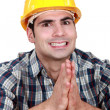 Stock Photo: Builder hoping everything goes as planned