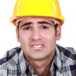 Stock Photo: Builder with pained expression on face