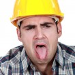 Construction worker with his tongue out - Stock Photo
