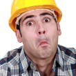 图库照片: Craftsman making a funny face