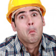 Stock Photo: Craftsmmaking funny face