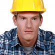 Stock Photo: Confused looking builder