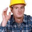 Dumbfounded construction worker - Stock Photo