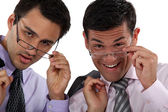 Duo of executives with glasses lowered — Stock Photo