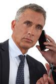 Close-up of businessman talking on his cell — Stock Photo
