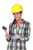 Tradeswoman holding a hammer and chisel — Stock Photo