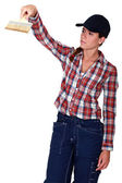 Woman using a paintbrush — Stock Photo