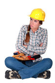Female laborer blowing — Stock Photo